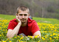 Free Handsome Young Man Laying In A Meadow Royalty Free Stock Images - 9065289