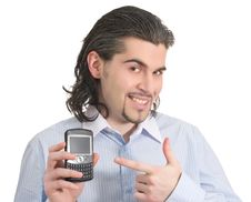 Free Young Handsome Male Pointing At His Phone Stock Images - 9060664
