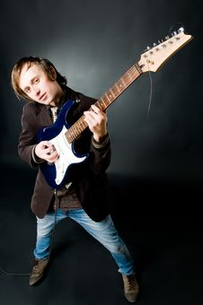 Free Young Man Playing Electro Guitar Royalty Free Stock Photo - 9063815
