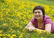 Free Young Woman Lying In A Meadow Stock Photography - 9065072