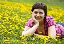 Free Young Woman Lying In A Meadow Royalty Free Stock Images - 9065119