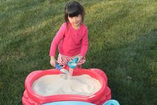 Free Asian Girl Playing In A Sand Table Royalty Free Stock Image - 9067796