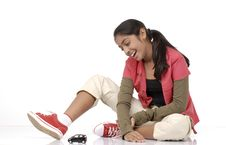 Free Girl Looking At Toy Car Stock Photography - 9068632