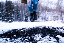 Free Person In Blue Distressed Denim Jeans Jumping On Snow Coated Land Near In Green Trees During Daytime Royalty Free Stock Photography - 90612647