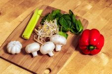 Free Cutting Board With Mushrooms And Vegetables Royalty Free Stock Image - 90613316