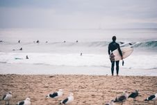 Free Man With Surfboard Looking At The Waves Stock Image - 90614581