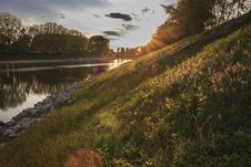 Free River Bank At Sunset Royalty Free Stock Photos - 90660748