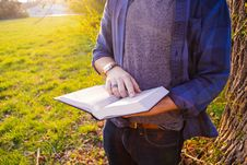Free Man Wearing Blue And Black Flannel Shirt Holding White And Black Book During Daytime Royalty Free Stock Photo - 90661445
