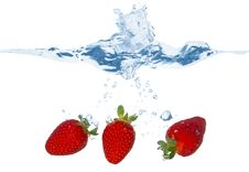 Free Three Strawberries Falling Into The Water Royalty Free Stock Image - 9070396