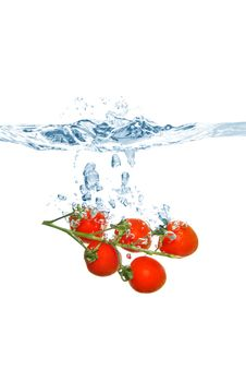 Cherry Tomatoes Falling Into The Water Stock Images