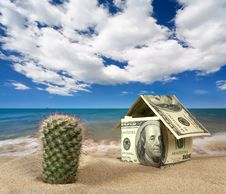 Free Dollar House On Sand. Royalty Free Stock Photos - 9071368