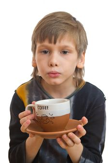 Free Boy Blow To The Cup Of Coffee Stock Photos - 9074083