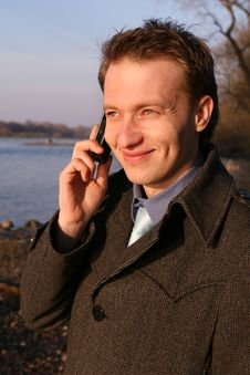 Free Happy Man On Mobile Phone Stock Image - 9075031