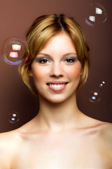 Young Woman With Soap Bubbles Stock Image