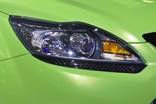 Free Headlight Bumper Of Green Sport Car Royalty Free Stock Images - 9075659