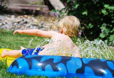 Free Small Boy Playing Water Games Royalty Free Stock Photos - 9077648