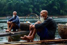 Free Two Men Sitting On Riverbank Royalty Free Stock Image - 90717306