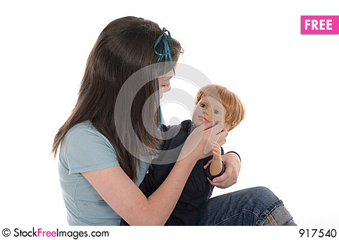Free Girl Playing With Doll 2 Stock Photo - 917540
