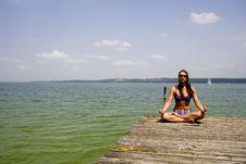 Free Meditating On Pier Royalty Free Stock Image - 911706