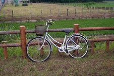 Bicycle On A Fence Royalty Free Stock Image