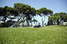 Free Man Lie On The Grass Stock Image - 919151