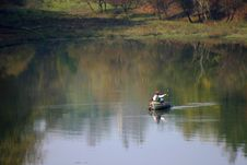 Men In A Rowboat Fishing In A Lake Royalty Free Stock Photos
