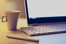 Free Computer And Coffee On Desktop Stock Photo - 91054980