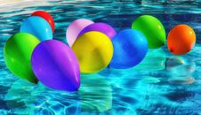 Free Purple Yellow And Blue Balloon On Swimming Pool Stock Photo - 91250210