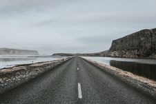 Free Empty Road Through Waterway Stock Photo - 91252380