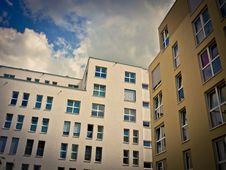 Free Modern Buildings Against Clouds Royalty Free Stock Photography - 91519707