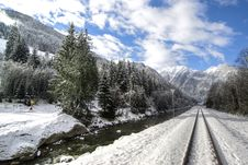 Free Snow Covered Railroad Tracks In Mountains Royalty Free Stock Image - 91519796