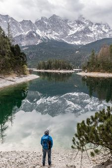 Free Hiker On Banks Of Alpine Lake Stock Photos - 91520083