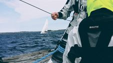 Free Man Holding Cable On Sailboat Royalty Free Stock Photo - 91520305