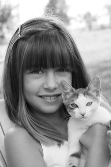 Girl Holding A Cat Stock Images