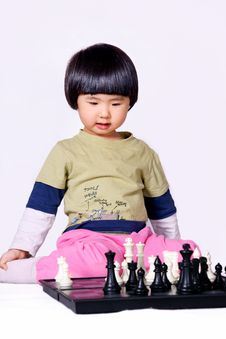 Girl Playing Chess Stock Photography