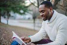 Free Black Man Reading Book In Park Royalty Free Stock Image - 91629236
