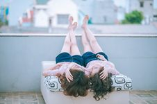 Free Twin Girls In Day Bed Outdoors Stock Photo - 91629500
