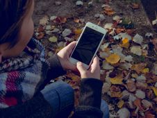 Free Teenage Girl Holding Smartphone Royalty Free Stock Image - 91630096
