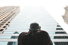 Free Man In Front Of Skyscraper Stock Photos - 91630723