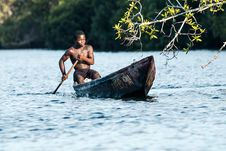 Free Man In Black Shorts Riding Rowboat During Daytime Stock Images - 91664184
