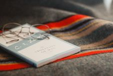 Free Book And Glasses On Blanket Royalty Free Stock Image - 91665926