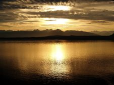 Free Calm Sea Near Mountain At Sunset Stock Photo - 91666470