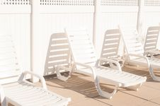 Free 3 White Plastic Outdoor Lounge Chair On Brown Tiled Floor During Daytime Stock Photo - 91756900