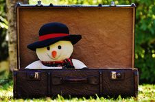 Free Snowman Plush Toy In Suitcase Royalty Free Stock Image - 91757066