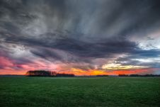 Free Storm Clouds Over Field During Sunset Stock Photo - 91757410
