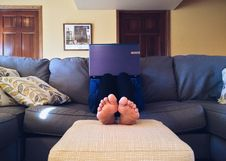 Free Person On Sofa With Laptop Royalty Free Stock Images - 91757739