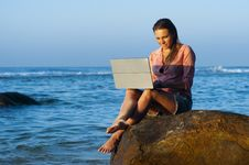 Free Woman Working On Laptop On Beach At Sea Royalty Free Stock Photo - 91758485