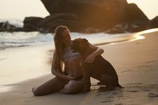 Free Woman On Beach With Dog Royalty Free Stock Image - 91758486