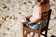 Free Girl Drinking Coffee On Beach Royalty Free Stock Photo - 91758515