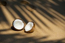 Free Halved Coconut On Beach Stock Images - 91758764